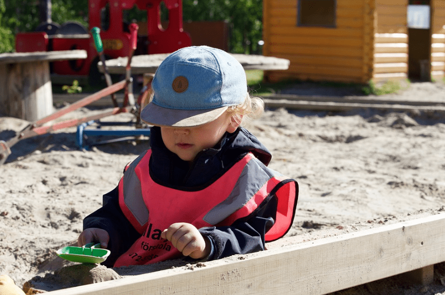 A child playing in a sandbox